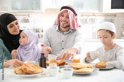 Happy Muslim family having breakfast together at home © Africa Studio