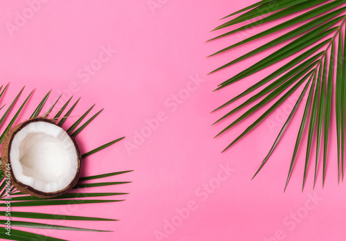 Palm leaves and half of coconut on the pink background - 196636764