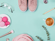 Cute feminine accessories and coffee on the pastel background, top view