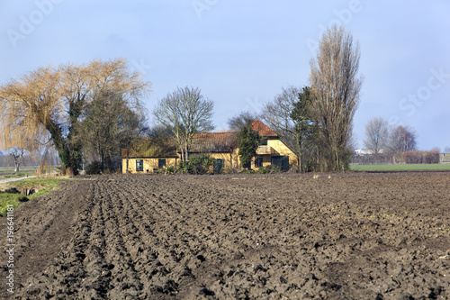 Blue sky Plowed field in the Netherlands