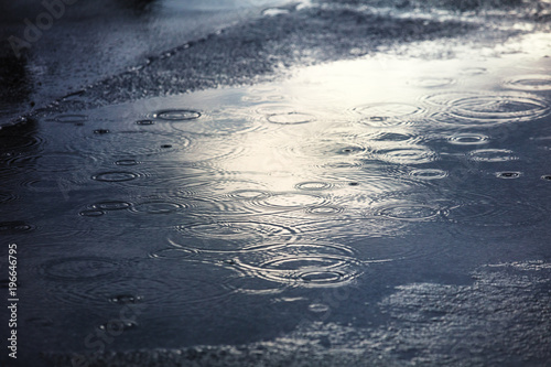 rain puddles on a pavement in city - 196646795