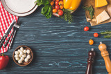 top view of vegetables on wooden table in kitchen