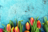 Festive background setting for Easter with eggs and tulips.