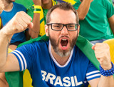 Brazilian supporters at stadium bleachers. - 196657716