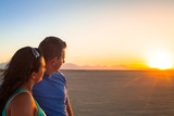Couple looking together at sunset on the desert - 196668927