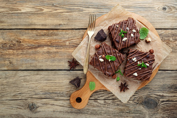 Chocolate brownie cake, dessert with nuts on wooden background.top view