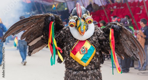 Oruro carnival in Bolivia with masked dancer during procession