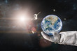 Earth with a spacecraft launched into space in the hands of astronaut. Elements of this image furnished by NASA.