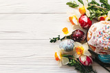 happy Easter concept. stylish painted eggs and easter cake on rustic wooden background with spring flowers, top view. seasons greeting card. space for text. modern flat lay - 196683397