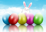 Easter bunny and eggs on a blue sky background