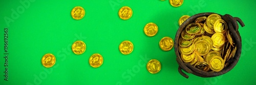 St Patricks Day pot filled with chocolate gold coins - 196692563