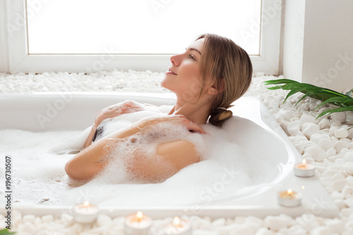 8fa281b16604e Keep your beauty! Attractively good-looking sexy young girl in bikini lying  in soothing