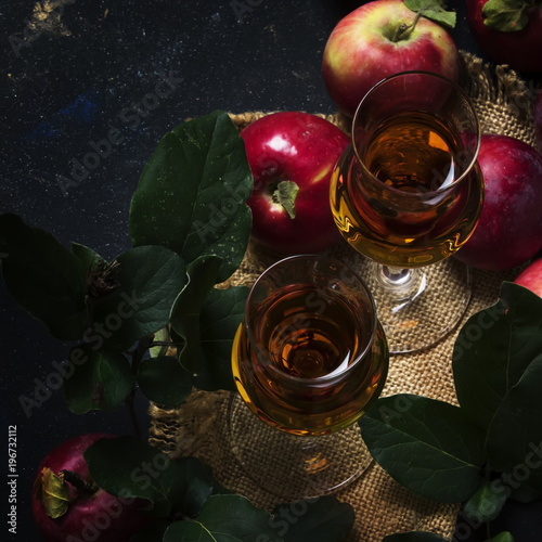 French apple brandy, dark background, top view