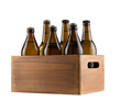 Craft beer bottles in wooden box isolated on white background