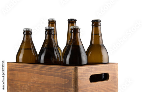 Foto Murales Craft beer bottles in wooden box isolated on white background