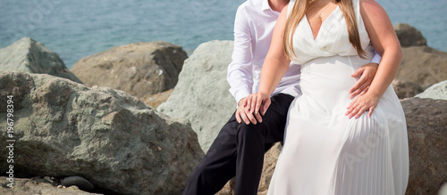 The bride and groom on the beach - 196798394