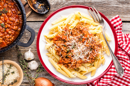 Pasta bolognese. Macaroni served with a classic italian bolognese stew sprinkled with Parmesan cheese - 196799595