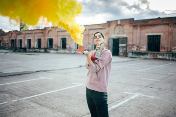 Graffiti artist with spray can and smoke bomb