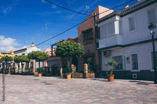 Fototapeta Street. A little street in the old town. Estepona, Malaga, Spain. Picture taken – 15 march 2018.
