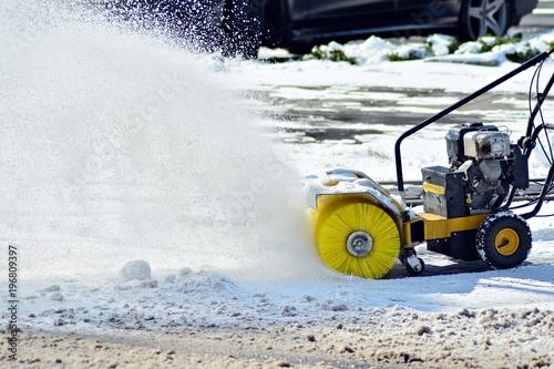 Fotobehang Trekker Removing the snow by snow blower