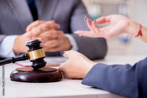 Lawyer discussing legal case with client - 196820340