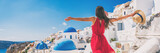 Europe travel vacation fun summer woman feeling free dancing with arms open in freedom at Oia, Santorini, Greece island. Carefree girl tourist banner panorama. - 196821190