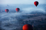 Red balls in the morning in the fog above Bagan. Bagan  is an ancient city located in the Mandalay Region of Myanmar