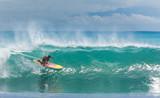 Surfer riding longboard on big green wave at Balangan beach, Bali, Indonesia - 196835320