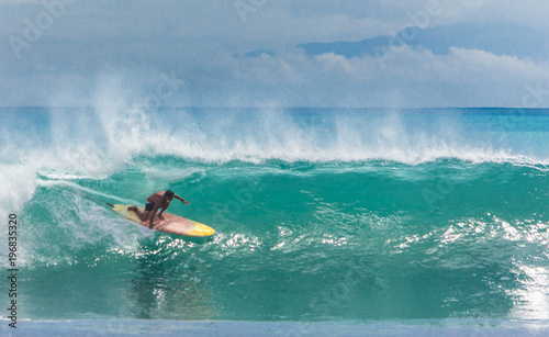 Fototapeta Surfer riding longboard on big green wave at Balangan beach, Bali, Indonesia