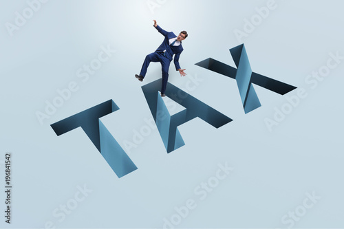 Businessman in tax financial and business concept - 196841542