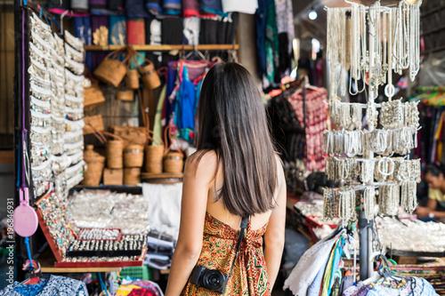 Fotobehang Bali Young woman traveler at ubud market in bali