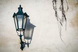 Antique lamp on a wall at natural lighting. Prague. Czech Republic