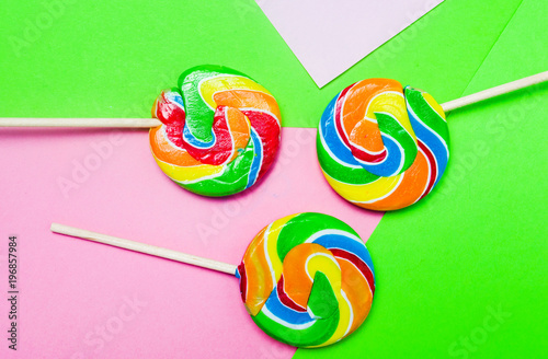 Lollipop candy on colorful background