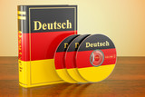 German book with flag of Germany and CD discs on the wooden table. 3D rendering - 196863955
