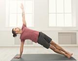 Fitness man plank training indoors