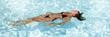 swimming pool beauty girl swiming on back in bikini