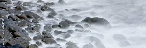 streaming water on the beach - 196873921