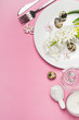 Spring Easter Table setting with hyacinth flowers on a pink background