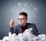 Businessman behind crumpled paper - 196883304