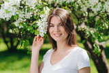 Woman near blooming apple tree