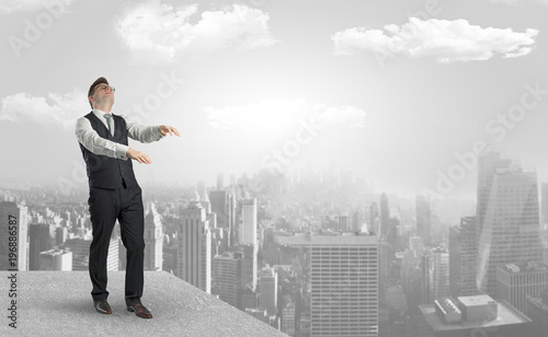 Fototapeta Sleepy businessman on the top of the city