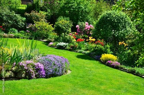 Leinwanddruck Bild beautiful garden with perfect lawn