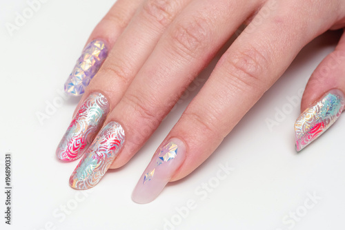 Foto op Canvas Manicure Nail Design. Close-up. Stylish manicured hands and glittery color against a white background