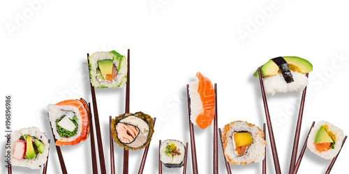 Traditional japanese sushi pieces placed between chopsticks, separated on white background. - 196896986