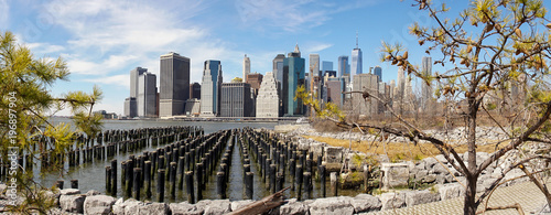 Views on Manhattan Skyline from Brooklyn Bridge Park in New York City. - 196897904