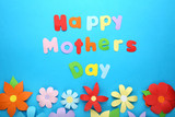 Inscription Happy Mothers Day with paper flowers on blue background - 196905510