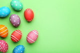Colorful easter eggs on green background - 196905799