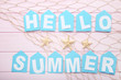 Inscription Hello Summer with starfishes and fishing net on wooden table - 196906139