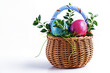 Colorful Easter eggs in a small Easter basket on a white background