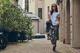 Beautiful fashionable brunette in a stylish clothing and sunglas - 196918176